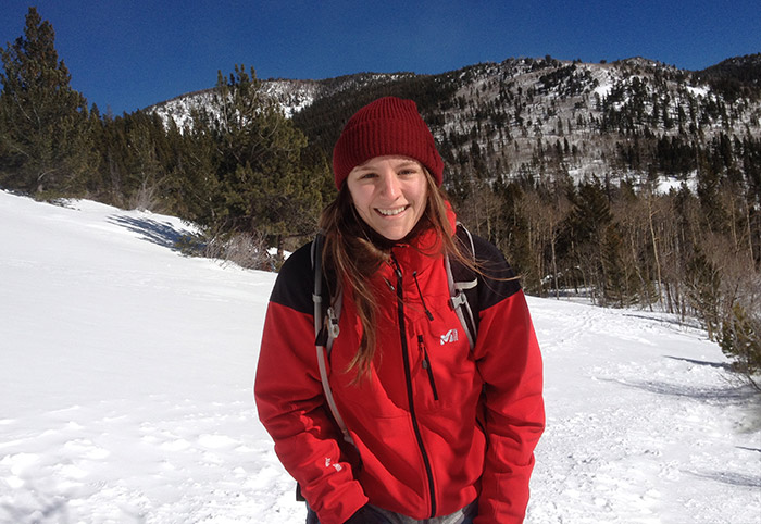 Marielle Martin snowshoeing in the mountains